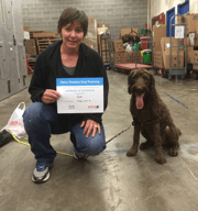 A dog getting a certificate for passing training